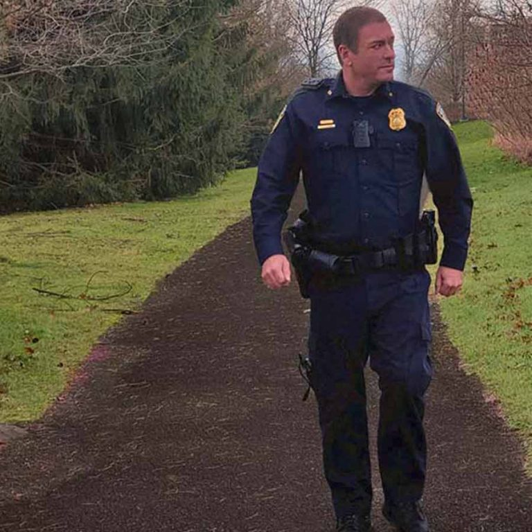 Security-Police Officer patrols hiking trail at luxury resort in PA